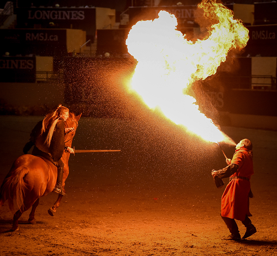 Breathing Fire: Performers reenact a medieval battle during the Medieval Horse at Liberty Fire Performance at the Longines FEI Show Jumping event in Calgary. The fire show included a fire breather, fire dancer and a skilled horse rider as they re-create the battle for the crowd. (Photo by Tyler Marr/The Press)