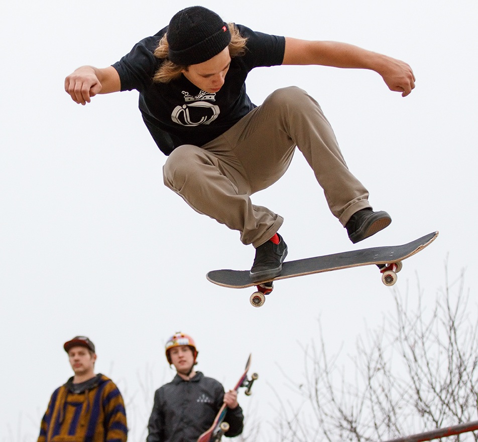 Big Air: Lucas Reid catches some air as other skaters watch, at the Shaw Millennium Park skateboard park. (Photo by Joshua Neumann/The Press)