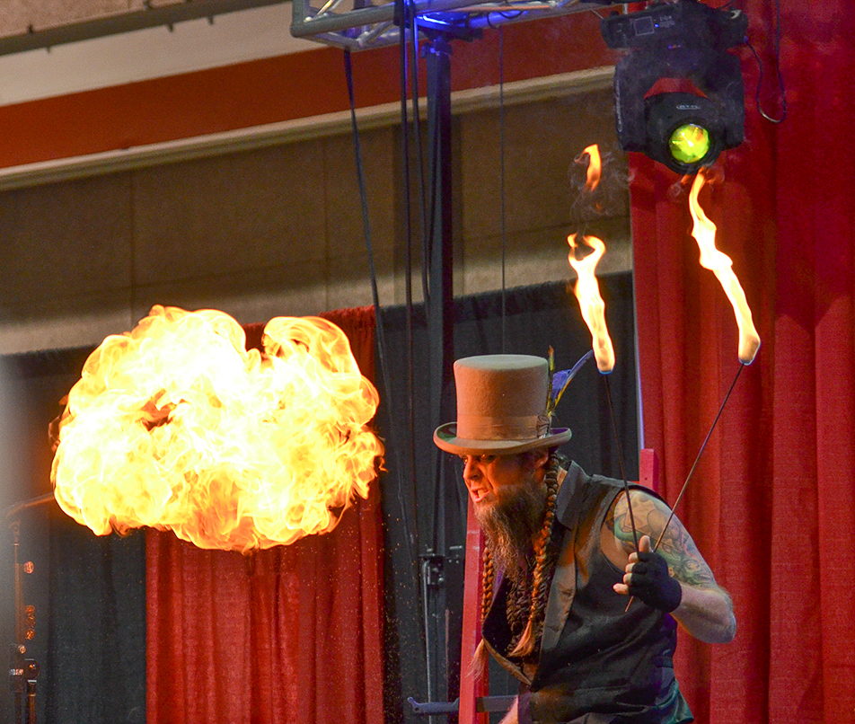 Ball of Fire: Performers from Hellzapoppin Circus Sideshow Revue perform at the Calgary Tattoo and Arts Festival at the BMO Centre. (Photo by Shayla Deeton/The Press)