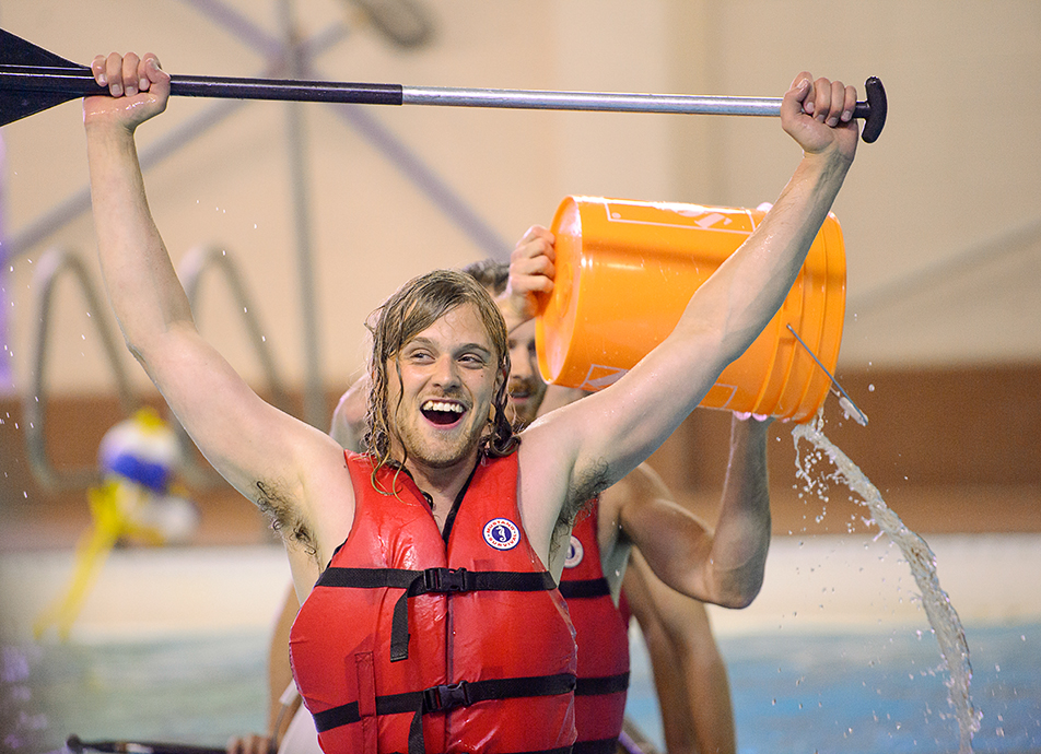 Battleship H2O: Currie Macaulay celebrates after sinking another team's canoe during the H20 Battleship championship at the Aquatic Centre in SAIT's Campus Centre. (Photo by Andy Maxwell Mawji/The Press)