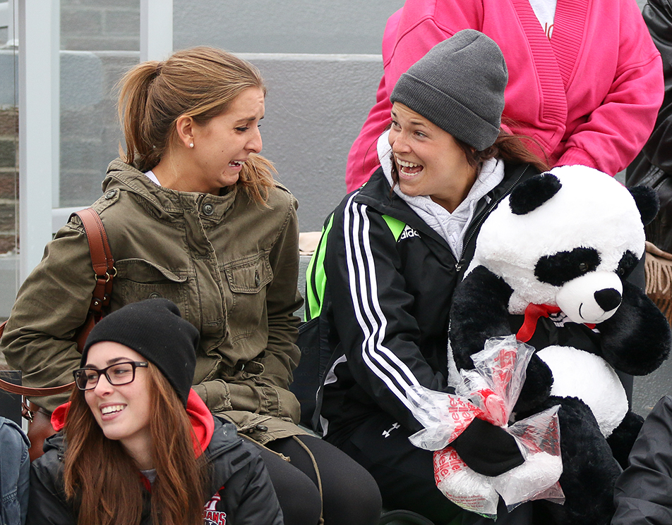 Soccer Fans: Lauren Good, right, the goal keeper for the Red Deer Queens women's soccer team, shares a laugh with her fellow teammate as she holds a stuffed panda while watching a soccer match at SAIT's Cohos Commons Field. (Photo by Joshua Neumann/The Press)