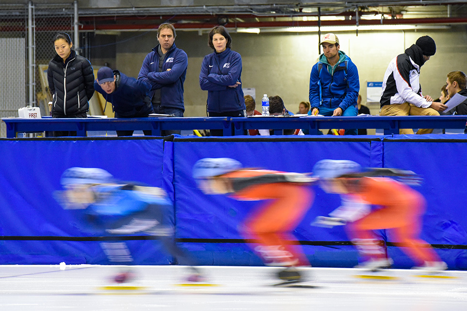 Coaches yell words of encouragement and tips while the women racers fly by during the Intercontinental Short Track Invitational at the Olympic Oval in Calgary on Saturday, Oct. 10, 2015. Both men and women skaters competed in the 1000 metre race held between 12:30 p.m. and 3:30 p.m.. (Photo by Kenneth Appleby/The Press)