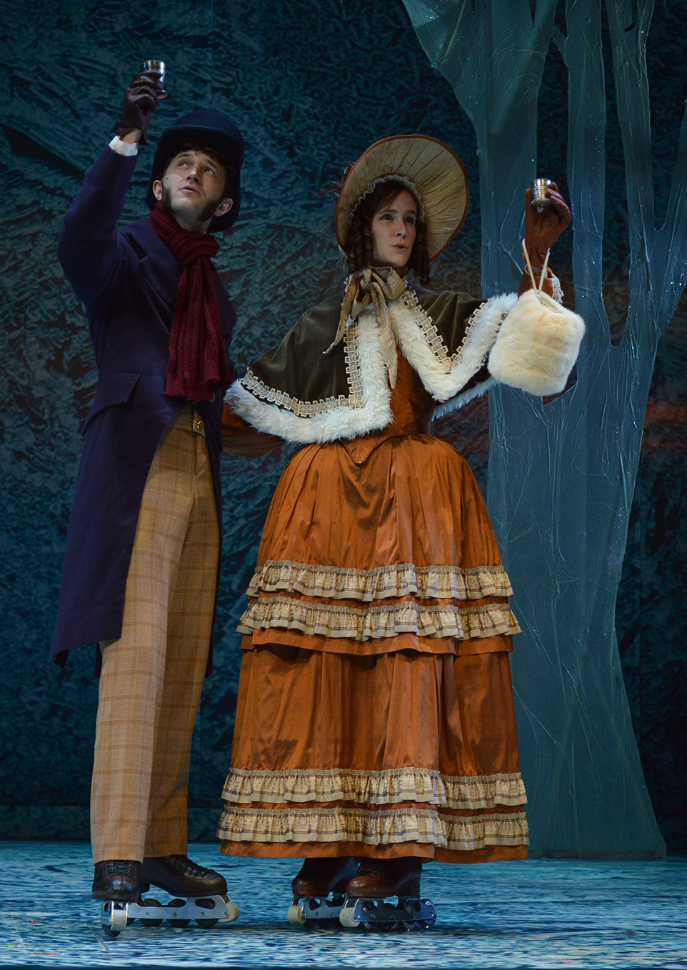 Time to Toast: Braden Griffiths, left, and Paula Humby toast in a scene of A Christmas Carol during a run through before opening night. (Photo by Jordan Johnston/The Press)