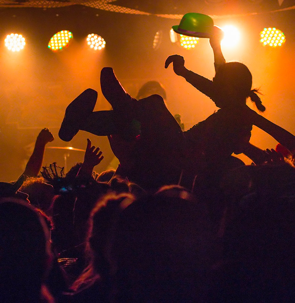 Surfer: A crowd surfer is silhouetted by the stage lights during The Dudes Halloween concert at The Gateway at the SAIT Campus Centre. The Dudes were accompanied by No Sinner on Stage and Bend Sinister. (Photo by Andy Maxwell Mawji)