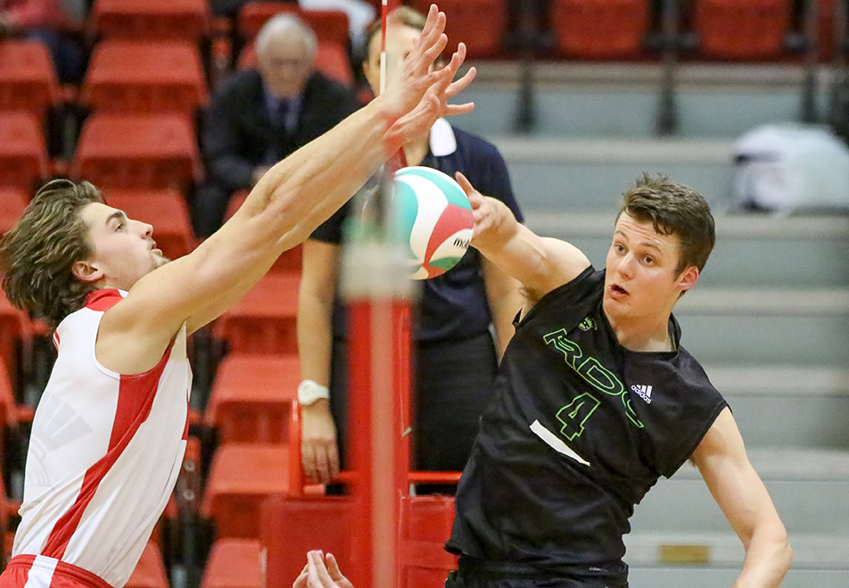 Blocked: SAIT Trojan's Steven Guebert, left, goes for a block against Red Deer's Luke Brisbane during ACAC men's volleyball action at the SAIT Campus Centre. The Kings defeated the Trojans 3 sets to 2. (Photo by Kyle Meller/The Press)