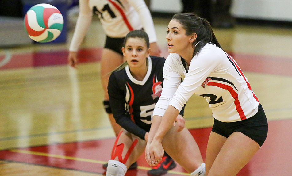 Diggin It: Megan Brennan digs up the ball during in a matchup agains the Red Deer Queens during ACAC women's volleyball action at the Campus Centre on Friday, Nov. 6, 2015. The Trojans defeated the Kings 3 sets to 2. (Photo by Kyle Meller/The Press)