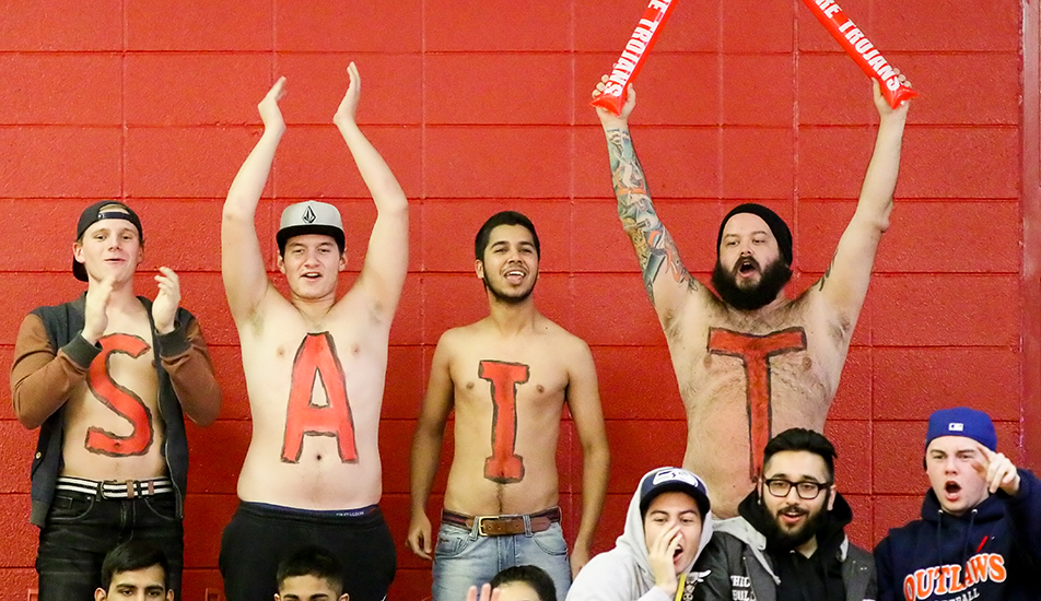 Colourful Fans: Trojan's volleyball fans painted their bodies in a show of support for the men's and women's volleyball teams during their matchup against the Red Deer Queens on Friday, Nov. 6, 2015. (Photo by Kyle Meller/The Press)