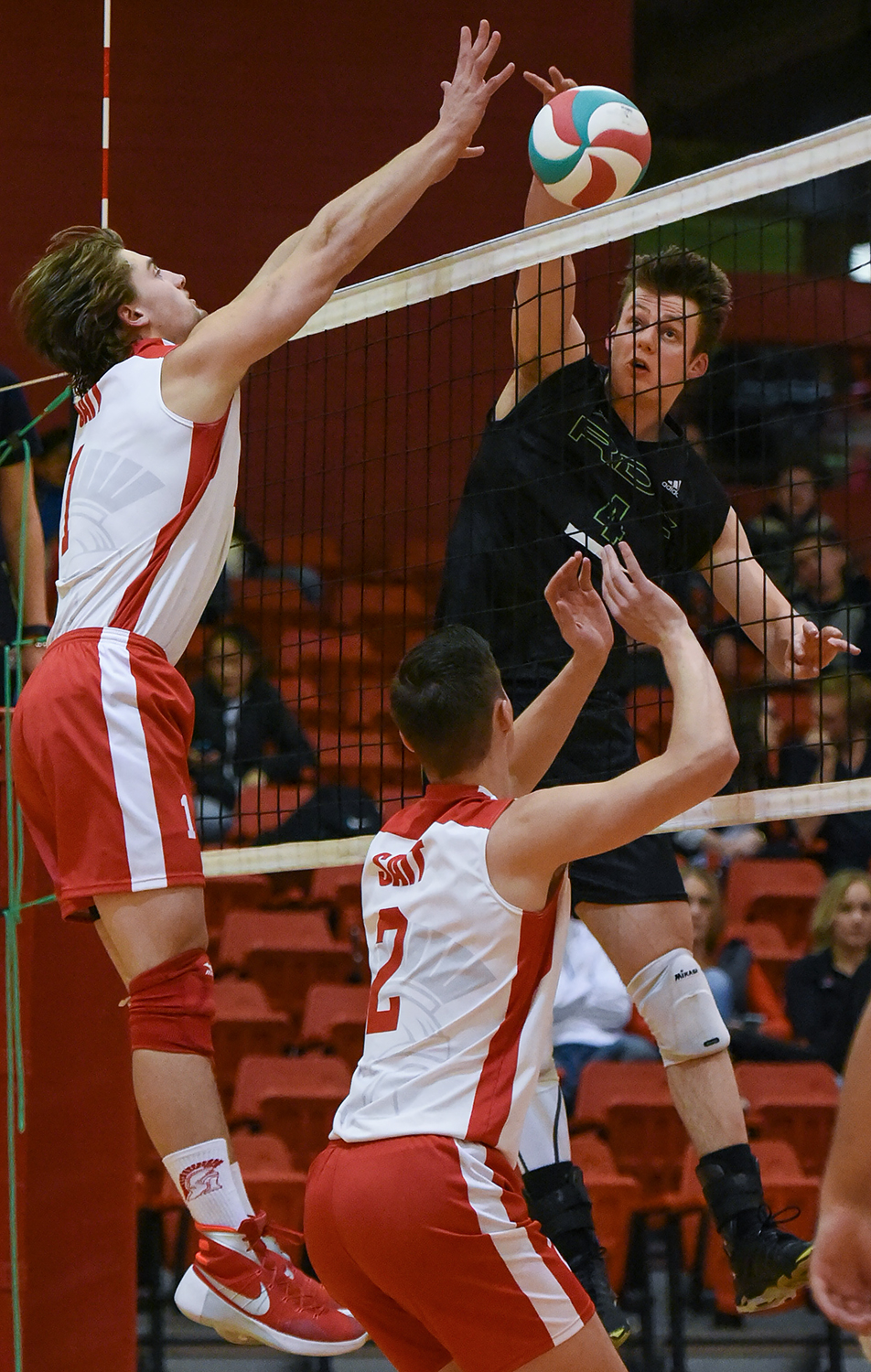 Big Block: Steven Guebert, left, of the SAIT Trojans blocks a tip from Red Deer College Kings setter Luke Brisbane during ACAC Men's volleyball action against the Kings at the SAIT Campus Centre on Friday, Nov. 6, 2015. The Trojan's lost the match by a score of three sets to two. (Photo by Elizabeth Cameron/SAIT Polytechnic)