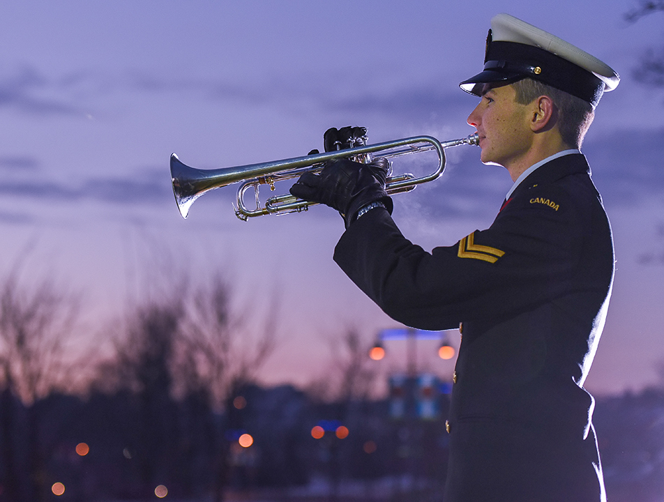 Paying Tribute: Jordan Shephard plays Taps at the Field of Crosses memorial project in Calgary on Monday, Nov. 9, 2015. The annual project, set up along Memorial Drive, has a flag ceremony at sunrise and sunset everyday until November 11. (Photo by Elizabeth Cameron/The Press)