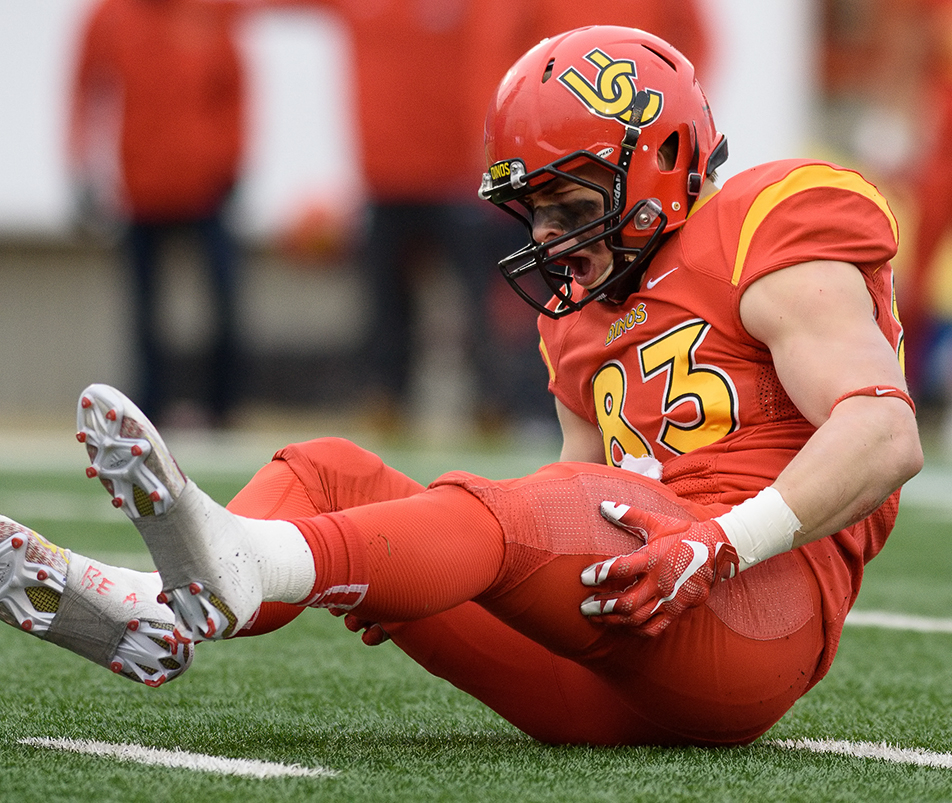 Tough Hit: University of Calgary Dino's receiver Brendon Thera-Plamondon shouts out in pain after a hard hit by a University of British Columbia Thunderbird during the Hardy Cup at McMahon Stadium in Calgary on Saturday, Nov. 14, 2015. The Thunderbirds upset the Dino's 34-26 to win the Hardy Cup, and advance further in the CIS playoffs. (Photo by Kenneth Appleby/The Press)