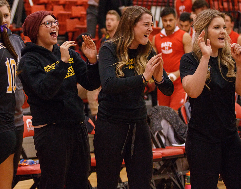 Excitement: Members of the Medicine Hat Rattlers women's volleyball team celebrate after winning their match against the SAIT Trojans at the SAIT gym on Saturday, Nov. 14, 2015. The Rattlers won 3-1. (Photo by Joshua Neumann/The Press)