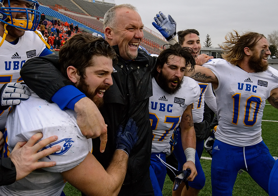 Winning Coach: UBC Thunderbirds head coach Blake Nill celebrates with his team as the 79th Hardy Cup game against the U of C Dinos finishes at McMahon Stadium in Calgary on Saturday, Nov. 14, 2015. The UBC Thunderbirds took the game 34-26. (Photo by Andy Maxwell Mawji/The Press)