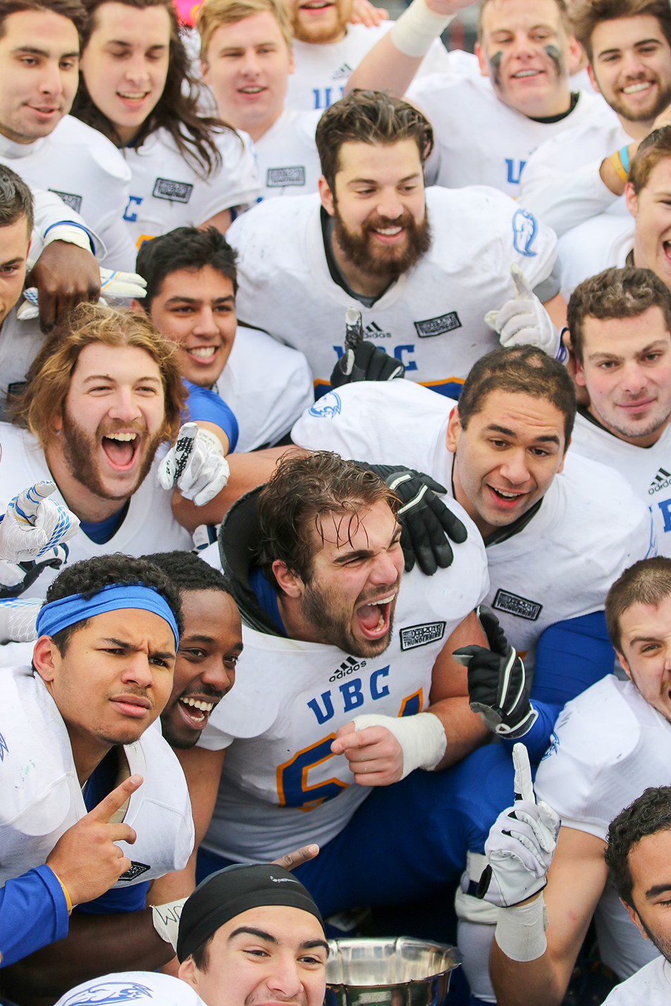 UBC Celebrates: Members of the UBC Thunderbirds celebrate their win over the U of C Dinos to take the Hardy Cup between at McMahon Stadium on Saturday, Nov. 14, 2015. The final score was 31-26 for the Thunderbirds. (Photo by Kyle Meller/The Press)