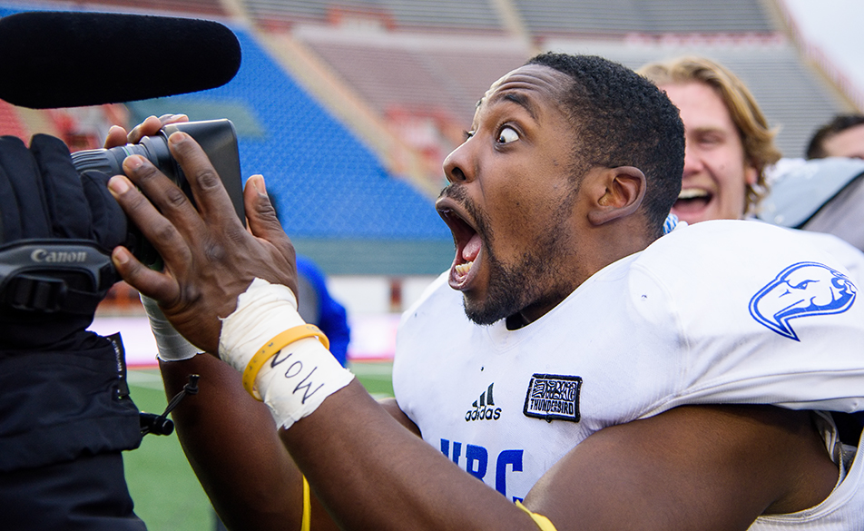 UBC Celebrates: The UBC Thunderbirds defensive back Warren Reece reacts to the lens of the CTV cameraman after winning the Hardy Cup final against the U of C Dinos at McMahon Stadium on Saturday, Nov. 14, 2015. The Thunderbirds won the game 31-24. (Photo by Brooke Hovey/The Press)