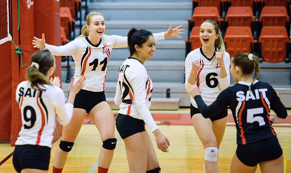 Trojan's Celebrate Members of the SAIT Trojans women's volleyball team celebrate a point scored against the Medicine Hat Rattlers at the SAIT Gym on Saturday, Nov. 14, 2015. The Rattlers won 3-1 against the Trojans, ending a six game winning streak. (Photo by Brooke Hovey/The Press)