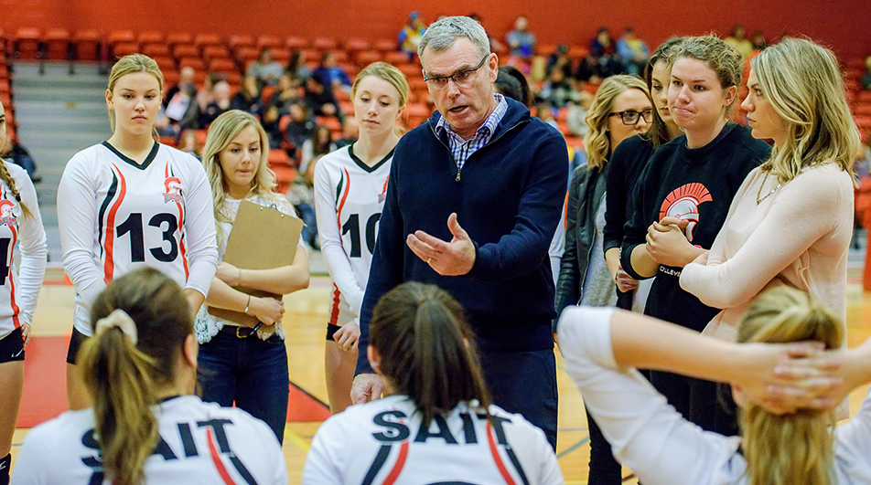 Wise Words SAIT Trojans head coach Art O'Dwyer encourages his team after the first set against the Medicine Hat Rattlers at the SAIT Gym on Saturday, Nov. 14, 2015. The Rattlers won 3-1 against the Trojans ending a six game winning streak. (Photo by Brooke Hovey/The Press)