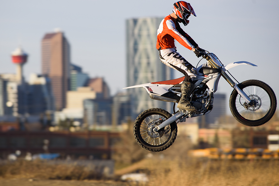 High Flyer: Chris Mammel of Calgary pilots his dirt bike over a jump with the City of Calgary skyline in the background Sunday, Nov. 15, 2015. Mammal was enjoying the unseasonably warm temperatures the city has had thought he month of November. (Photo by Adam F. Dullum/The Press)