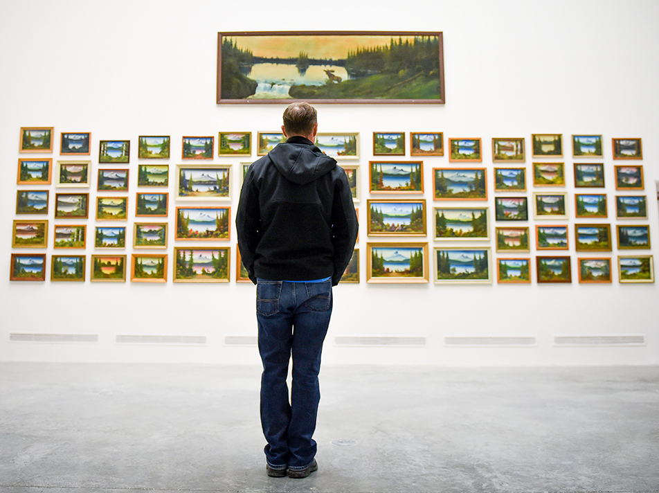 Wall of Art: A man peruses the artwork of Levine Flexhaug during the Alberta College of Art and Design Art Show and Sale. The hosted their 25th annual Art Show and Sale at ACAD on Friday, Nov. 27, 2015. (Photo by Tyler Marr/The Press)