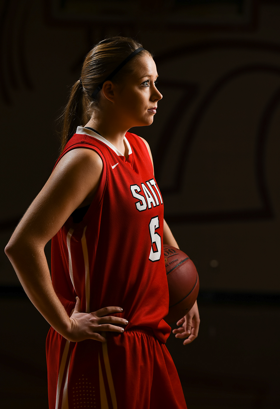 Portrait of a Trojan: Kendell Kuntz, a member of the SAIT Trojans Women's Basketball team poses for a portrait in the Campus Centre gym in Calgary on Thursday, Nov. 19, 2015. Kuntz was modelling for the second year photo-majors as a part of a location lighting workshop. (Photo by Kenneth Appleby/The Press)
