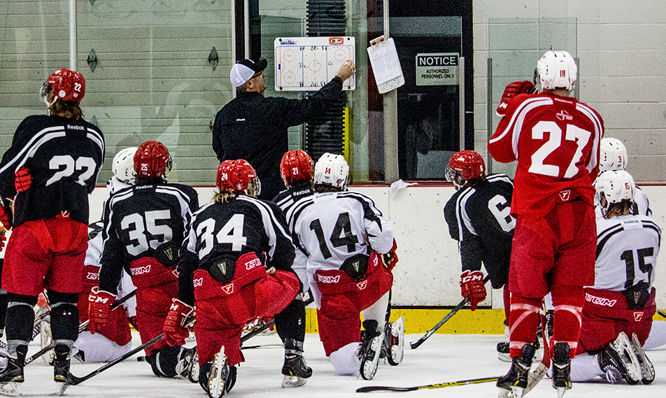 Giving Direction: Trojan's men's hockey head coach, Dan Olsen, draws up a drill during a practice at the SAIT arena on Tuesday, Nov. 17, 2015. (Photo by Shea Johnston/The Press)