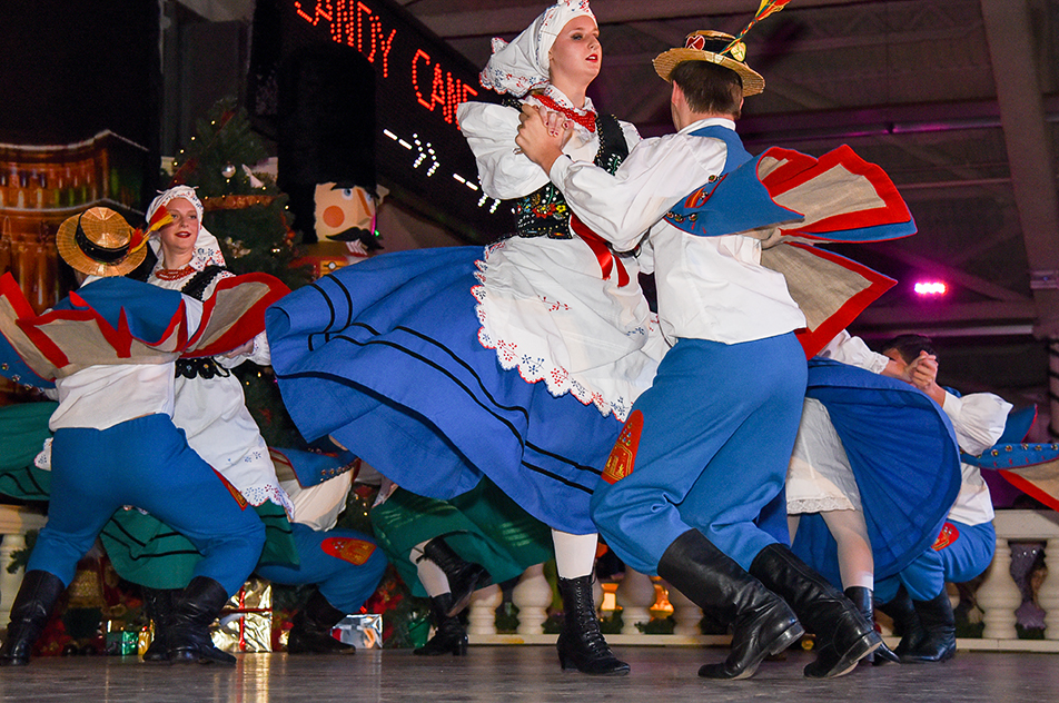 Colourful Dance Krakusy Polish Folk Dancers fly around the stage in the Equi-Plex building at the Spruce Meadows International Christmas Market in Calgary on Sunday, Nov. 22, 2015. International singers and dancers performed during the weekend events that also included hundreds of vendors, live animals, and food concessions. (Photo by Victoria Vadeboncoeur/The Press)