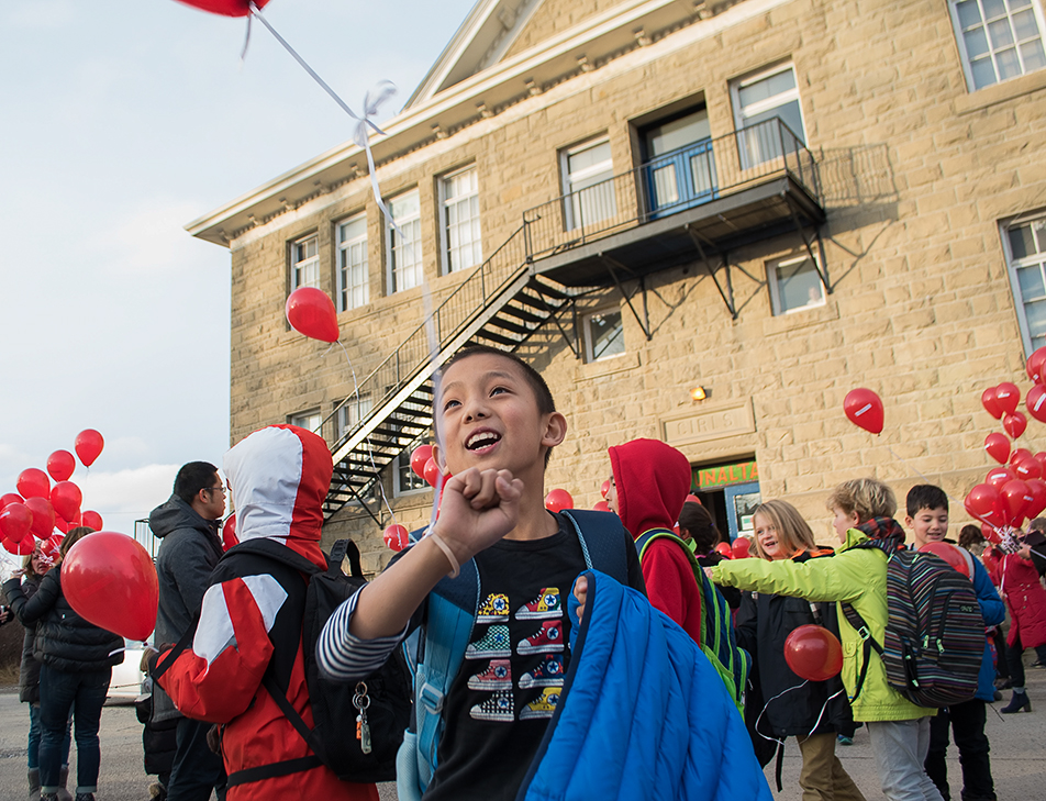 Balloons for Refugees Students at Sunalta School receive red balloons following the day's classes in Calgary on Monday, Nov. 23, 2015, in support of the Syrian refugee families being relocated to the city. The balloons are part of the 1000 Schools Challenge in which 1000 schools across Canada are each being asked to sponsor a refugee family. (Photo by Ryan Wellicome/The Press)