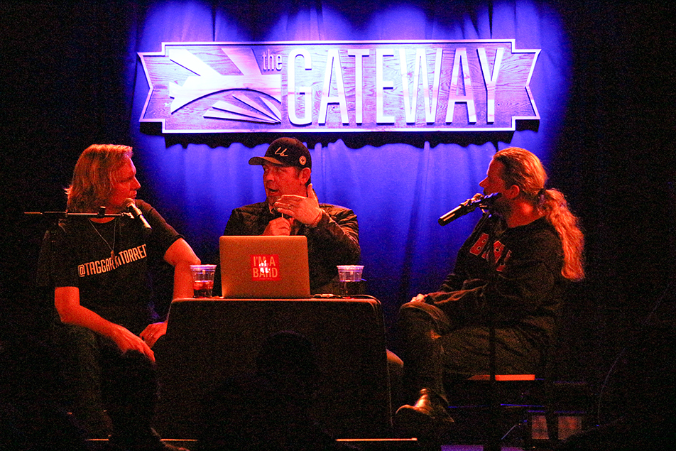 Wall of Art: Jonathan Torrens, left and Jeremy Taggart, right are joined by Former Calgary Flame Theo Fleury on stage during their November 19th show. Fleury talked about playing in the NHL, hoisting the Stanley Cup as well as the battles he faced on and off the ice. (Photo by Zach Laing)