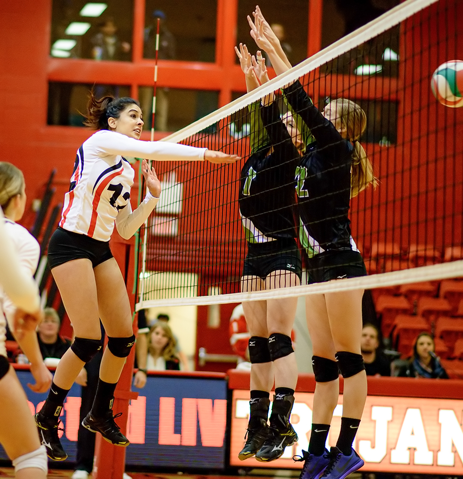 Spike: SAIT Trojans middle Sara Pauls spikes over a wall of Kodiaks players during ACAC women's volleyball action in the SAIT Gymnasium on Friday, Nov. 20, 2015. The Trojans won the game 3-0. (Photo by Brooke Hovey/The Press)