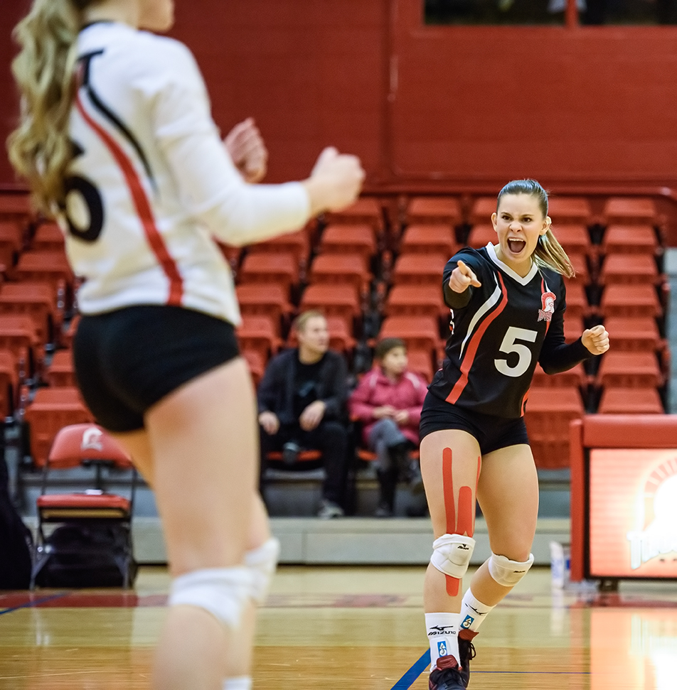 Celebrate: SAIT Trojan's libero Kayla Nixon, right, celebrates with teammate Chanelle Kayser during ACAC women's volleyball action against the Lethbridge Kodiaks at the SAIT gym on Friday, Nov. 20, 2015. (Photo by Vanessa Paterson/The Press)