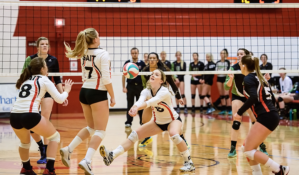 SAIT Trojan's setter Chanelle Kayser, 6, digs the ball during ACAC women's volleyball action against the Lethbridge Kodiaks at the SAIT gym on Friday, Nov. 20, 2015. (Photo by Vanessa Paterson/The Press)