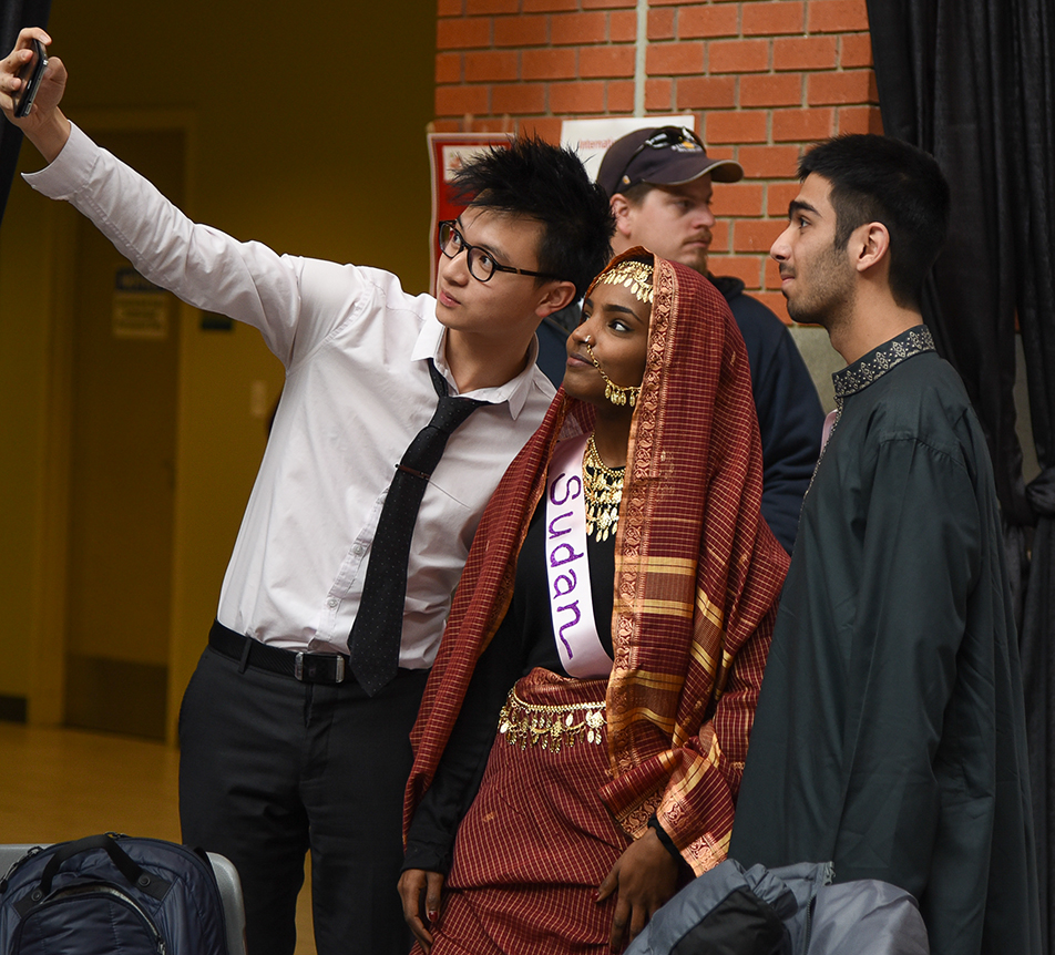 International Selfie: Students take selfie pictures of one another as they enjoy International Education Week on SAIT campus on Tuesday, Nov. 17, 2015. The event is meant to showcase the diversity of SAIT's student population. (Photo by Shayla Deeton/The Press)