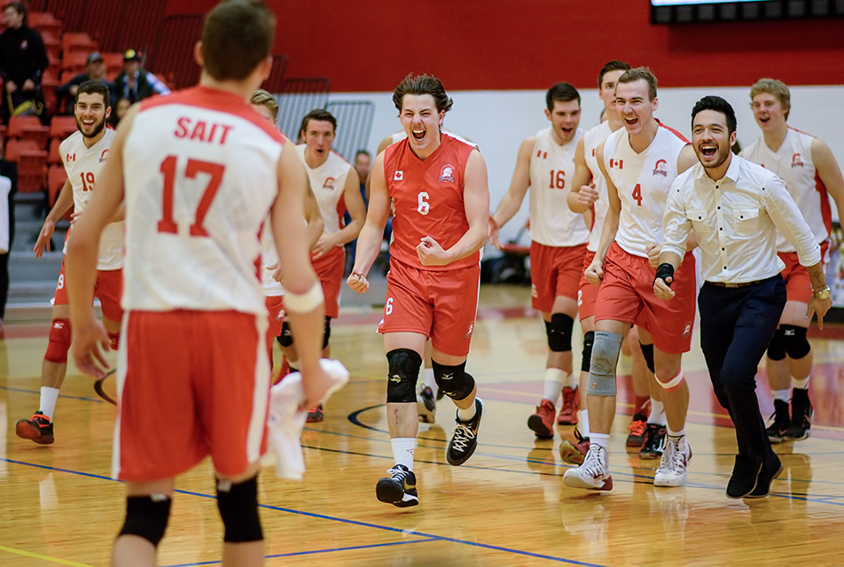 Celebration: The SAIT Trojans men's volleyball team celebrate their win against the Lethbridge Kodiaks at the SAIT Gymnasium on Friday, Nov. 20, 2015. The Trojans defeated the Kodiaks 3 games to 2. Russell Grusing (#17) won the player of the game honours. (Photo by Brooke Hovey/The Press)