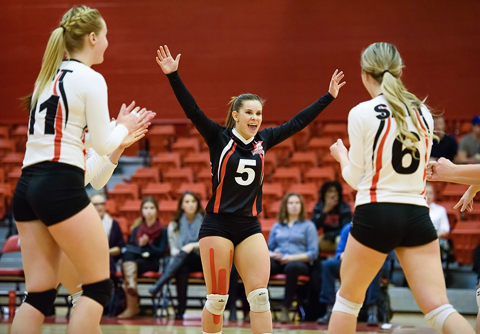 Celebrate: SAIT Trojan's libero Kayla Nixon, middle, cheers in celebration alongside teammates Hayli Hinchey, left, and Chanelle Kayser during ACAC Women's Volleyball action against the Lethbridge Kodiaks at the SAIT gym on Friday, Nov. 20, 2015. (Photo by Vanessa Paterson/The Press)