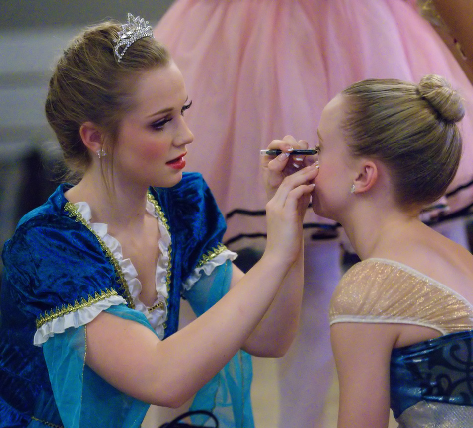 Seeing Double: Sydney Moncrieff, left, fixes Sophia Bekker's makeup before a dress rehearsal at Absolute Dance in the Dalhousie area in Calgary on Friday, Nov. 27, 2015. Moncrieff and Bekker play the character Elsa in the ballet production of Frozen. (Photo by Brooke Hovey/The Press)