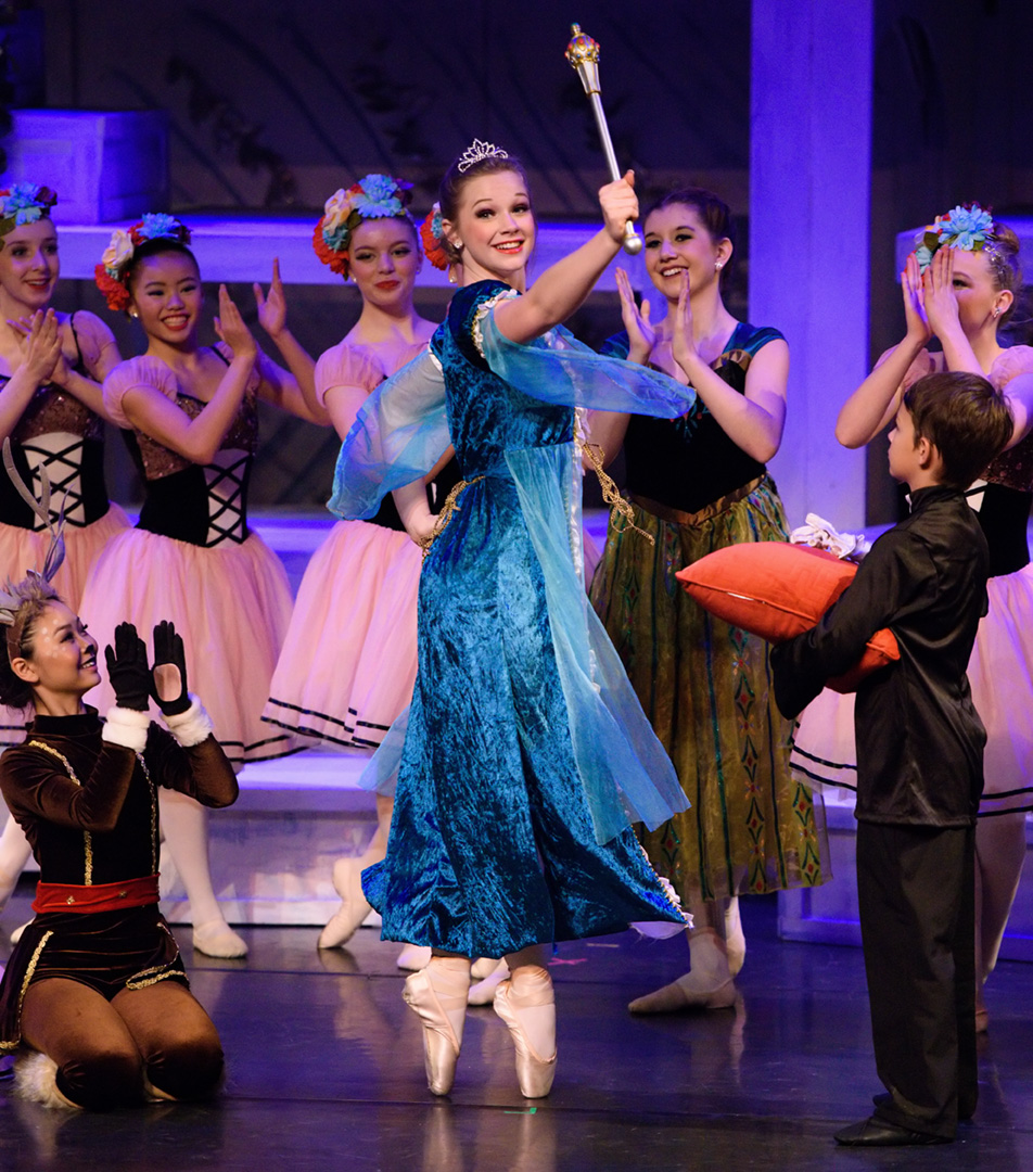 Let it Go: Sydney Moncrieff, centre, plays queen Elsa as she accepts the magical orb and spectre before the townspeople of Arendelle in the ballet performance 'Frozen' presented by Absolute Dance at the Wright Theatre on Mount Royal University campus in Calgary on Sunday, Nov. 29, 2015. (Photo by Brooke Hovey/The Press)