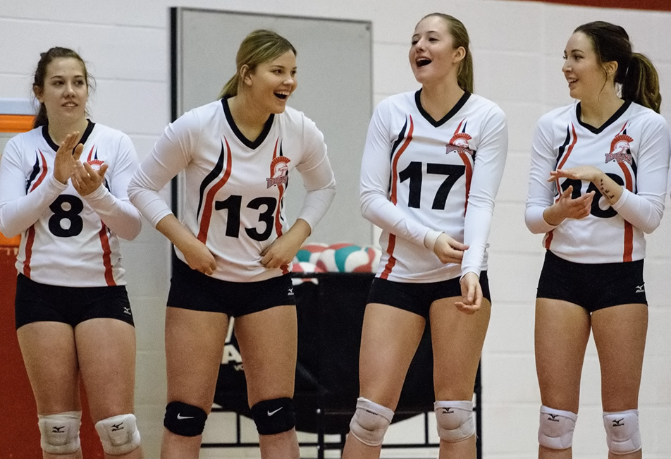 Chatter Away: The SAIT Trojans women's volleyball team cheers on the sidelines during their game against the Lethbridge College Kodiaks at SAIT's Campus Centre gym in Calgary on Saturday, Jan. 30, 2016. The Trojans won the action packed Alberta Colleges Athletic Conference women's volleyball contest by a score of 3-0. (Photo by Vanessa Paterson/The Press)
