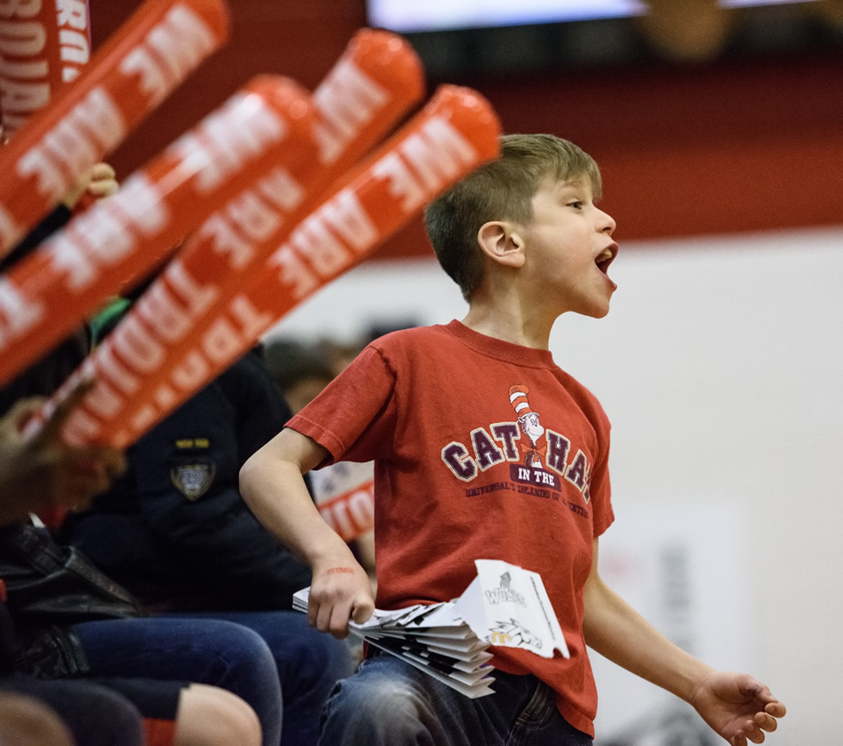 Go Team: A young Trojan fan cheers excitedly during a Trojans women's volleyball game against the Lethbridge College Kodiaks at SAIT's Campus Centre gym in Calgary on Saturday, Jan. 30, 2016. The Trojans won the action packed Alberta Colleges Athletic Conference regular season contest by a score of 3-0. (Photo by Vanessa Paterson/The Press)