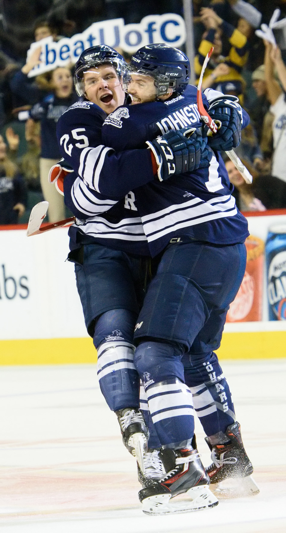 Cougar Cuddle: Mount Royal University defenceman Matt Bellerive, left, celebrates a goal with defenceman Mackenzie Johnston. (Photo by Brooke Hovey/The Press)
