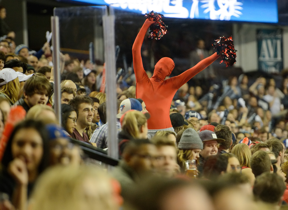 Standout Fan : Steven Heits shows his commitment to the Dinos by donning his bright red morphsuit. (Photo by Andy Maxwell Mawji/The Press)