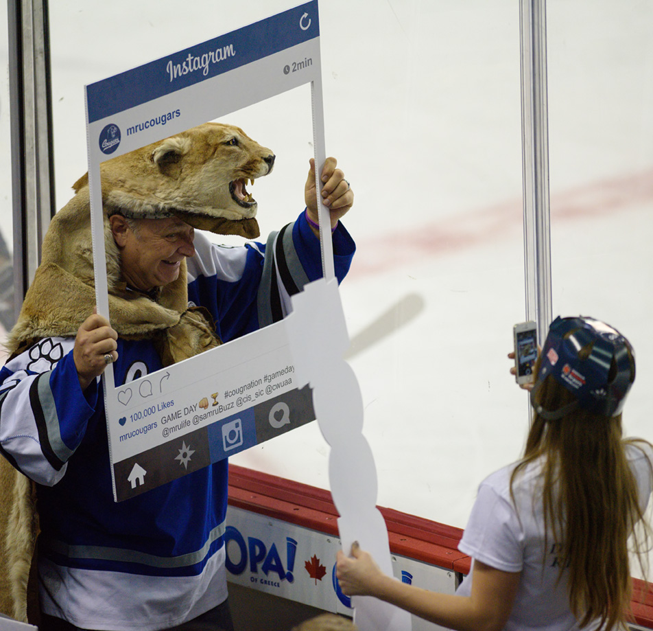 Captured Cat: A Mount Royal Cougars fan poses for a fun Instagram photo during the intermission. (Photo by Kenneth Appleby/The Press)