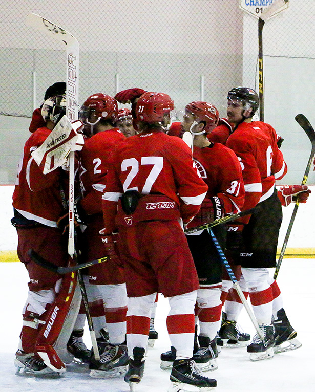 Sweet Victory: The SAIT Trojans men's hockey team go out on the ice to congratulate and celebrate with goaltender Bolton Pouliot after they skated away with a victory over the Innisfail Eagles during the exhibition game part of the annual Eye Opener Tournament at SAIT Arena in Calgary on Friday, Sept. 16, 2016. With the tournament ending, the Trojans now look forward to the start of the regular season in a quest to bounce back after a disappointing end to last season. (Photo by Alex Medina/The Press)