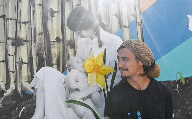Kai Cabodyna gazes at a print of his significant other Ricole, and their newborn, Indiana, in Calgary on Friday, Sept. 23, 2016. Originally Ricole's project, Kai stepped in to help finish the mural after their son was born. (Photo by Foster Modesette/The Press)
