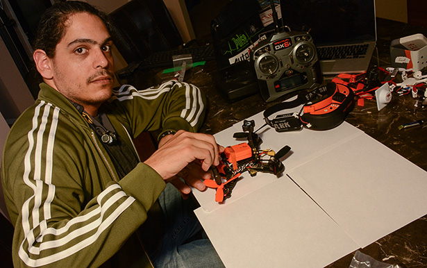 Drone Maintenance: UAV(Unmanned Aerial Vehicle) enthusiast Christopher Huot does a pre-flight check with his custom made quadcopter in Calgary, Alberta on Wednesday, Sept. 28, 2016.