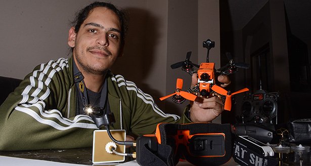 Orange-Four-Inch: Christopher Huot displays his custom made FPV (First Person View) quadcopter in Calgary, Alberta on Wednesday, Sept. 28, 2016. Named the 'Foranger' after it's orange colour scheme and four-inch propellors.