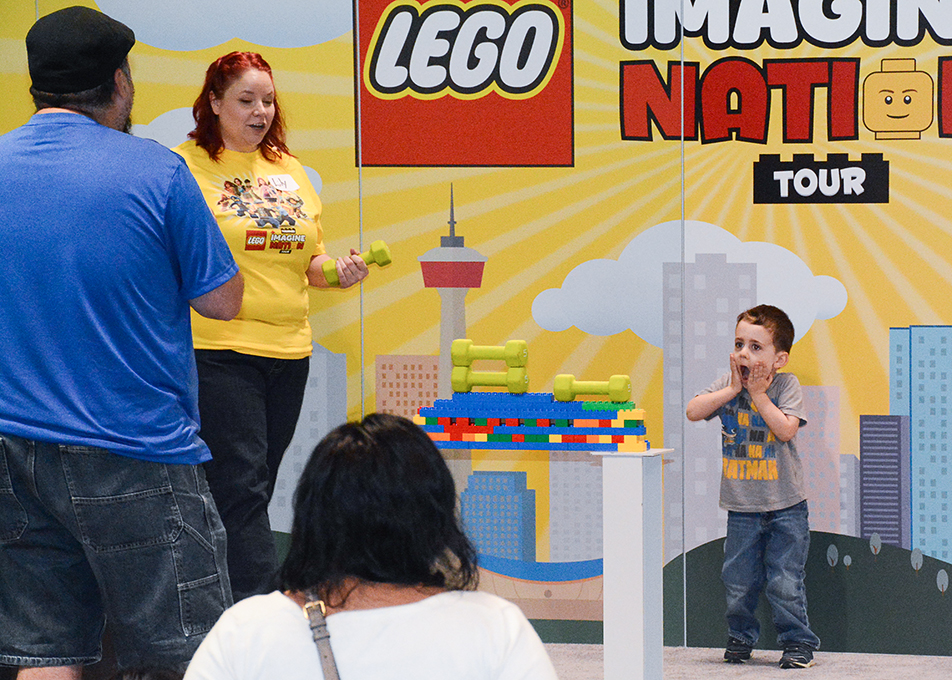 An excited participant of a bridge building competiton is over joyed to see his Lego piece hold 15lbs at the Lego Imagine Nation Tour at the BMO Centre in Calgary on Friday, Sept. 9, 2016. The Imagine Nation Tour is a ticketed, indoor and cross-country tour with activities and life-size LEGO® models. (Photo by Kelsey Zeoli/The Press)