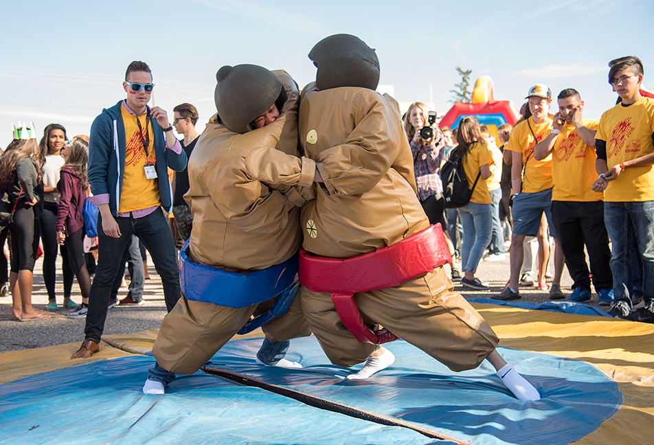 University of Calgary students participated in a sumo suit game after the annual Red Light, Green Light guinness world record event in Calgary on Friday, Sept. 9, 2016. The Red Light, Green Light game plans on having a record shattering attendance after a 10 year held record. (Photo by Terri Huxley/The Press)