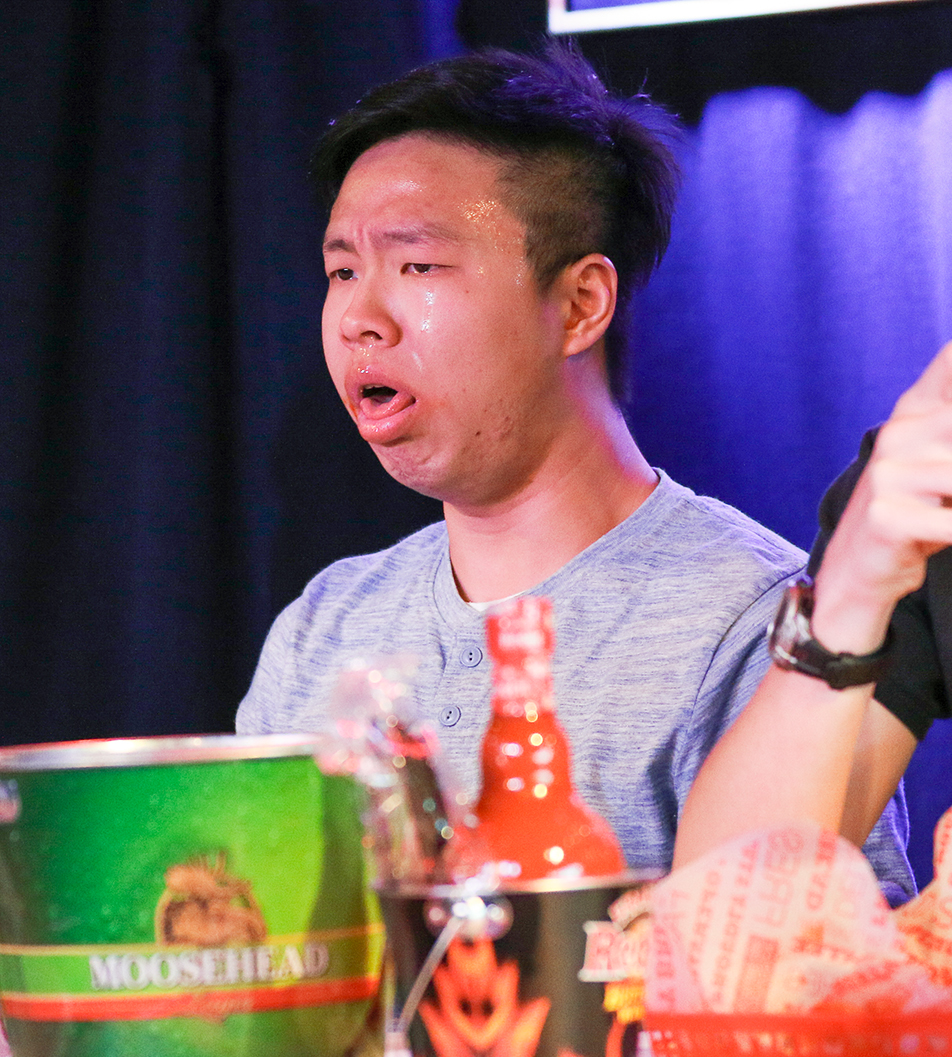 Edmund Kai feels the heat while competing in a hot wing eating contest at the Gateway at SAIT in Calgary on Friday, Sept. 9, 2016. There were three different rounds throughout the contest and the winner of each round went on to compete in a final. The final winner of the contest was Mo Xue who received a $500 prize for his efforts. (Photo by Dawn Gibson/ The Press)