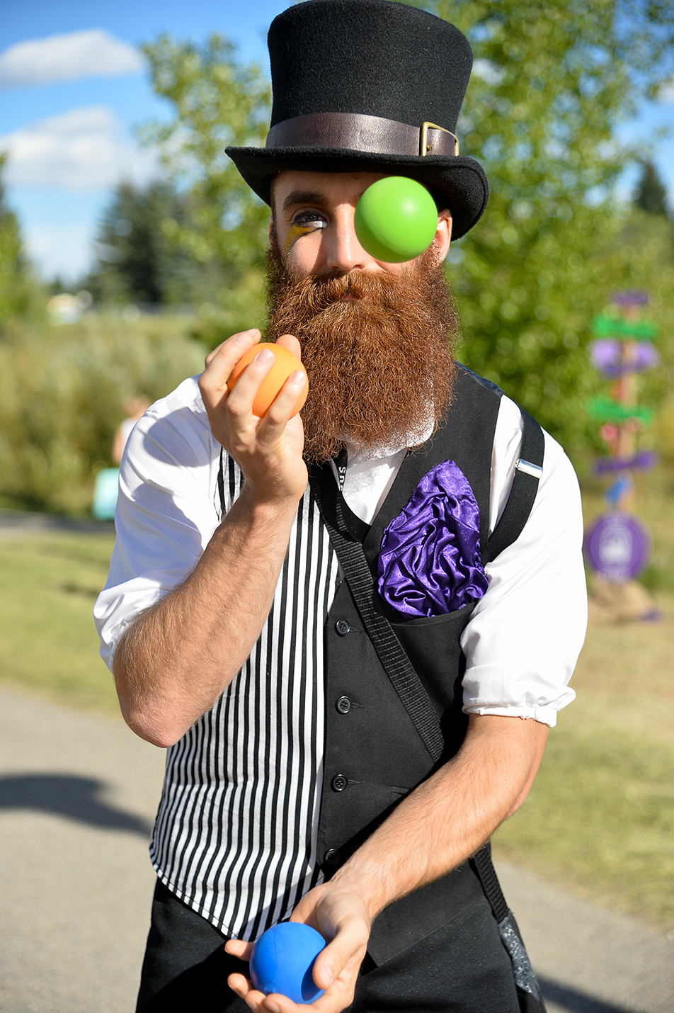 Eye on the Ball: Michael Bartz juggles during the Circle The Wagons event at University District South Park in Calgary. Bartz is a performer in the circus group, Cirque De La Nuit. (Photo by Ashley Orzel/The Press)