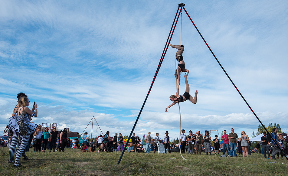 "Jenna Lencucha, top, and Katherine Odland perform a corde lisse, or free rope, act during the Circle the Wagons festival in Calgary on Saturday, Sept. 10, 2016. Corde lisse, which is French for ""smooth rope,"" is an aerial circus act that involves performing acrobatics on a vertically hanging rope. (Photo by Kayla Van Den Bussche/The Press)"