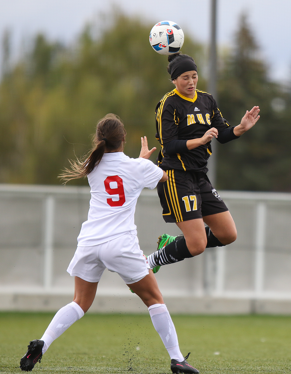 High Header: SAIT Trojans striker Emily Fedoriak, left, battles for the ball against Medicine Hat Rattlers defence Cassidy Larochelle during women's soccer action at SAIT in Calgary. The Trojans defeated the Rattlers 2-0. (Photo by Dawn Gibson/ The Press)